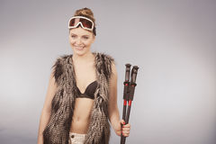 Beautiful girl has fur, brassiere and goggle. Royalty Free Stock Image