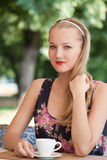 Beautiful girl has a rest in street cafe Royalty Free Stock Photos