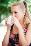 Beautiful girl has a rest in street cafe Stock Image