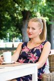 Beautiful girl has a rest in street cafe Stock Images
