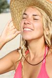 Beautiful girl in the hat. For sun tans Royalty Free Stock Photo