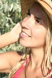 Beautiful girl in the hat. For sun tans Stock Images