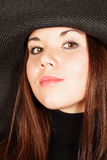 Beautiful girl in a hat Stock Images