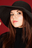 Beautiful girl in a hat Stock Photography