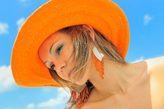 Beautiful girl with hat. And the blue sky Stock Photography