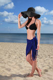 Girl on the beach. Beautiful girl in hat on the beach Royalty Free Stock Image