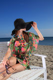 Girl on the beach. Beautiful girl in hat on the beach stock photography