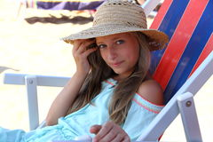 Beautiful girl in hat on beach Royalty Free Stock Photography