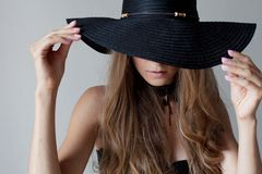 Beautiful girl in a hat with a brim fashion. 1 royalty free stock image