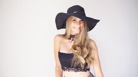 Beautiful girl in a hat with a brim fashion poses stock video footage