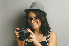 Beautiful girl in a hat with camera. Stock Images