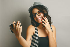 Beautiful girl in a hat with camera. Royalty Free Stock Photos