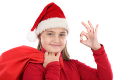 Beautiful girl with hat of christmas saying OK Royalty Free Stock Image