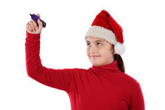 Beautiful girl with hat of christmas writing Stock Image