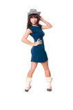 Beautiful girl in the hat, dress and boots Stock Photography