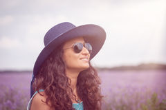 Beautiful girl with hat, enjoying the lavender field Stock Photo