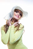 Beautiful girl in a hat enjoying the sun on the beach Royalty Free Stock Photography