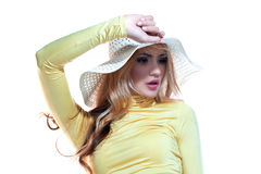 Beautiful girl in a hat enjoying the sun on the beach Royalty Free Stock Image