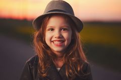 Beautiful girl with hat on evening sunset Stock Images