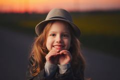 Beautiful girl with hat on evening sunset Stock Photography