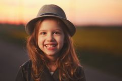 Beautiful girl with hat on evening sunset Stock Photos