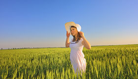 Beautiful girl with hat in the field Stock Photos