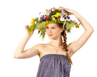 Beautiful girl with hat of flowers Royalty Free Stock Photos