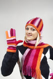Beautiful girl in a hat and gloves. On the background Stock Photography