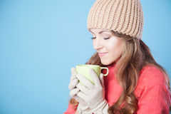 Beautiful girl in a hat and gloves, drinking hot tea Stock Photography