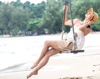 Girl on a swing on the beach of Thailand Royalty Free Stock Image