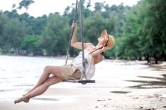Girl on a swing on the beach of Thailand Royalty Free Stock Photography