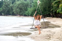Girl on the swing on the beach of Thailand Stock Image