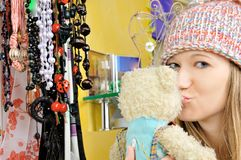 Beautiful girl in hat kisses teddy bear Royalty Free Stock Photos