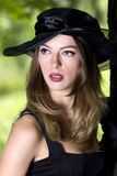 The beautiful girl in a hat. Portrait Royalty Free Stock Photography