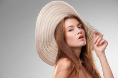 Beautiful girl with hat posing in studio Stock Photography