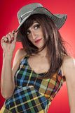 Beautiful girl with hat posing in studio Royalty Free Stock Photography