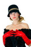 Beautiful girl in hat and red gloves Stock Image