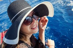Beautiful girl in hat relaxing on the boat and looking at the is Royalty Free Stock Photos