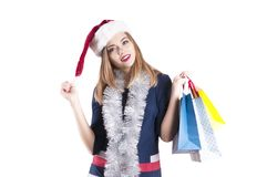 Beautiful girl hat santa gift model  celebration, young shopping Royalty Free Stock Images