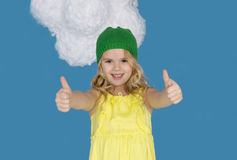 Beautiful girl in a hat showing sign of approval Stock Photography