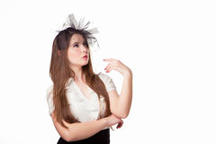 Beautiful girl in a hat. Girl shows the company logo Royalty Free Stock Photography