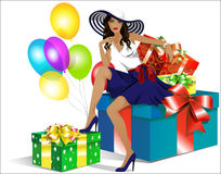 Beautiful girl in the hat sitting on the gift boxes Stock Photography