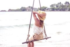 Girl on a swing on the beach of Thailand Stock Image