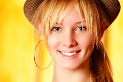 Beautiful girl in hat smiles Royalty Free Stock Photography