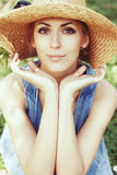 Beautiful girl in hat with white spring flowers Stock Image