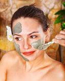 Beautiful girl having clay body mask. Stock Photo