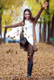 Beautiful girl having fun in the autumn. Stock Photography