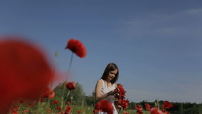 Beautiful girl having fun outdoors in the poppies field. Slow motion. stock video footage