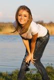 Beautiful girl having fun at the riverside Stock Photos