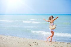 Girl having fun on tropical beach Stock Photo